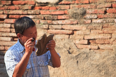 archaeologist: man looking though a microscope