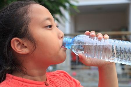 girl drinking fresh water from bottle Stock Photo - 12106742