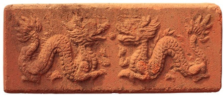 two dragon in old red sand stone block photo