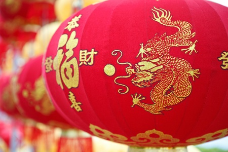 red chinese lanterns hang on ceiling photo