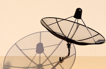 home satellite dish and shadow  photo