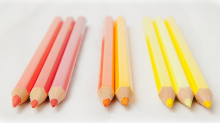 red orange yellow color pencil on white paper photo