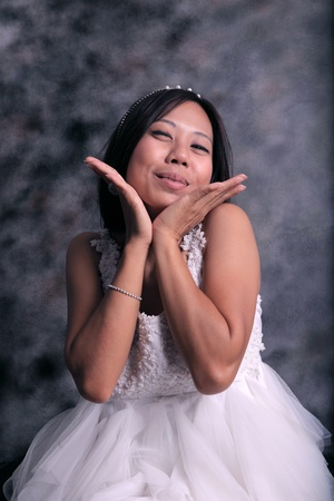 women in white dress bride happiness action in studio photo