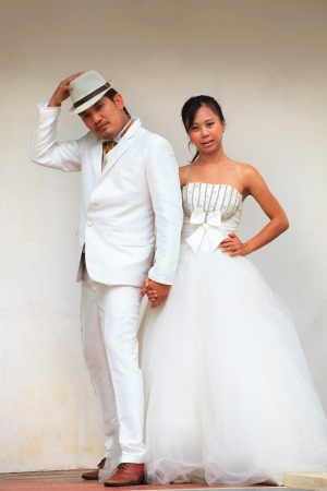 couples of asian people in wedding suit photo