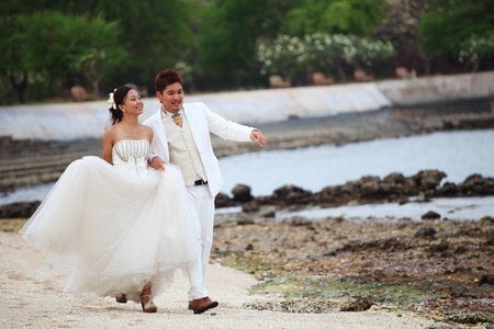 couples of lover walking on sea beach photo