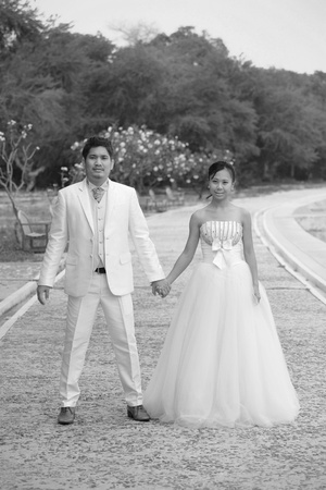 couples of asian people in wedding suit  standing on outdoor location photo