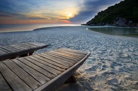 dusky: wood bed on beach in dusky sky  Stock Photo