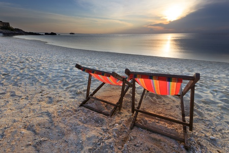 couples chairs beach and sunset  photo