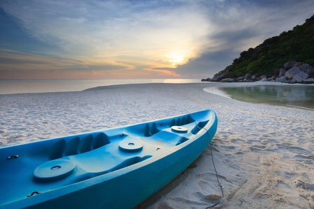 blue sea kayak on the beach photo