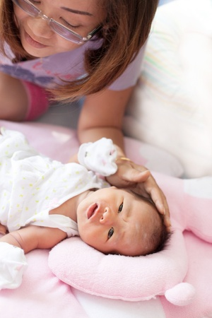 baby sick: woman and face of infant sleep on baby bed