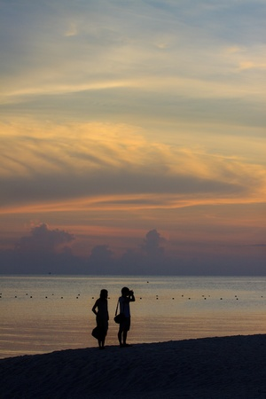 silhouette of couples at sea side photo