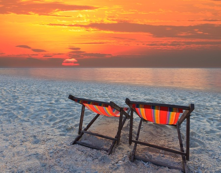 beach chairs: couples chairs beach on sand beach with colorful sky Stock Photo