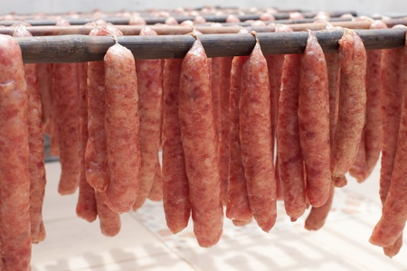 thai local pork sausage style drying on the bamboo line prepare for sale