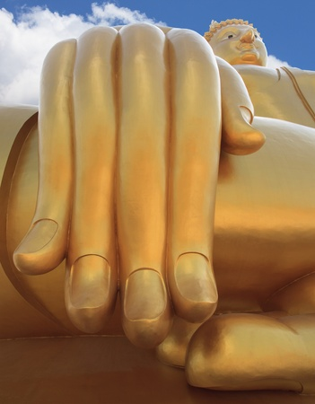 biggest:  big buddha statue hand and blue sky