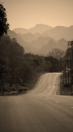 mountain road in sepia color photo