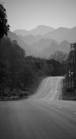 mountain road in black and white color photo