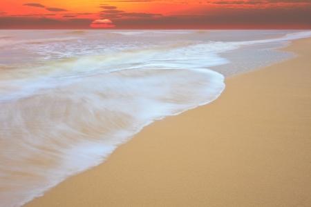 sun down: sun rise at sea beach show movement of sea wave