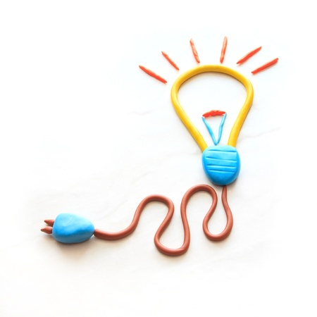 electric bulb icon on white background by colorful clay children style photo