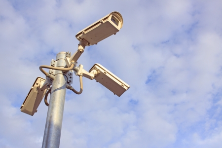 cctv camera watching to viewers  and other side photo