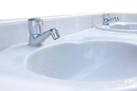 wash basin: Tap and washing sink wet water Stock Photo