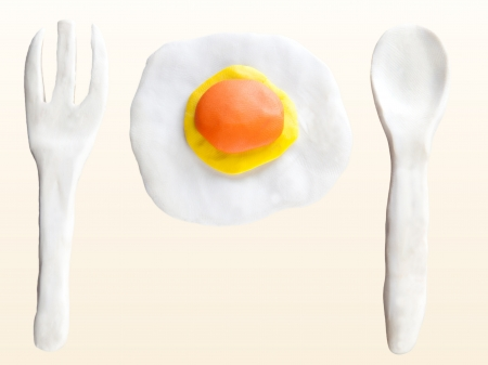 fryer: fried egg fork and spoon made from clay sculpture design