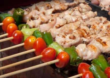 paprica: barbecue grill with tomato and green paprica Stock Photo