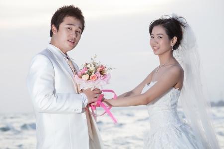 wedding couple: groom and bride on sea beach