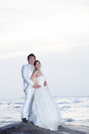 groom and bride on sea beach photo