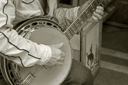 hand playing banjo guitar monotone color photo