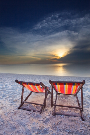 couples of chairs beach on sea beach photo
