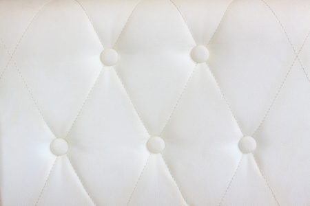 luxury white  leather with a botton use as background texture photo