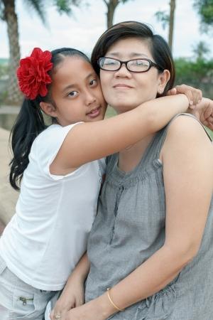 45 years old: asian girl hug on mother