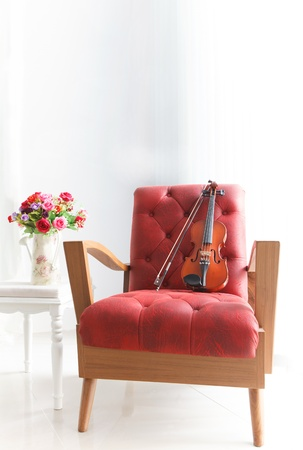 arm chair: ed leather wood arm chair with violin in white room