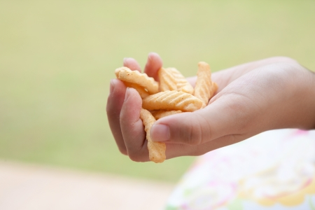 hand and snack food photo