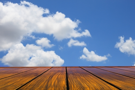 atmosphere: wood floor and blue sky white clouds Stock Photo