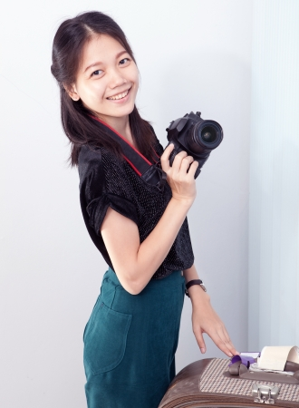 woman and camera in hand photo