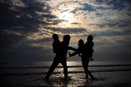 children playing on sea beach in the evening lignt Stock Photo - 14658854