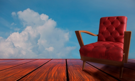 red  arm chairs on wood and blue background photo
