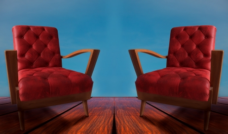 arm chairs: red couples arm chairs on wood and blue background Stock Photo