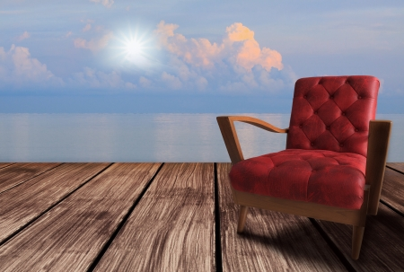 red chair: red  arm chairs on wood terrace and sun rise  Stock Photo