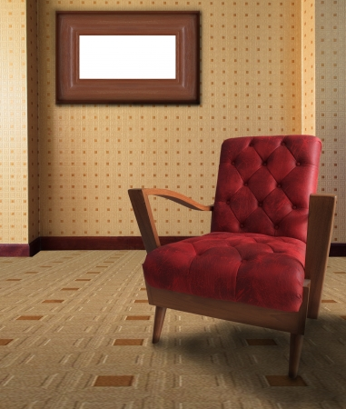 red arm chair in living room with picture frame on wall photo