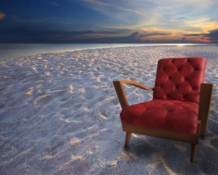 arm chair: red armchair on sand beach