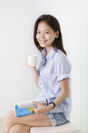 face of asian woman holding a cup of hot coffee Stock Photo - 15552697
