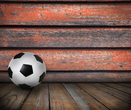pasto sintetico: fútbol de fútbol en la madera de textura de fondo