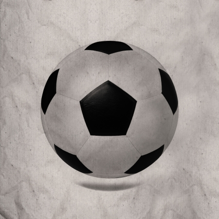 black and white soccer football on wrinkled paper texture photo