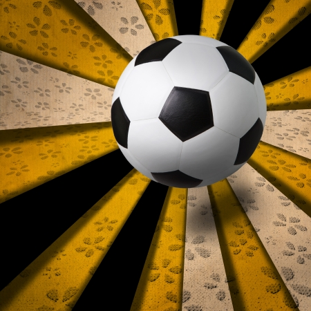 soccer football on yellow ray background photo