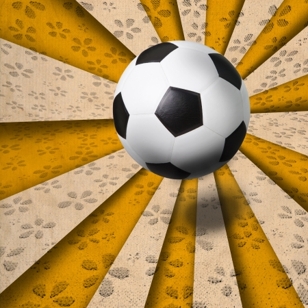 football pitch: soccer football on yellow ray background Stock Photo
