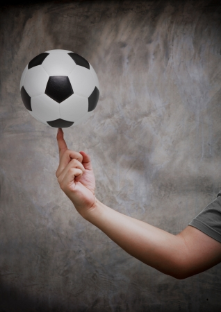 five objects: soccer football and hand Stock Photo