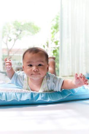 baby lied and  flying on baby bed Stock Photo - 15486873