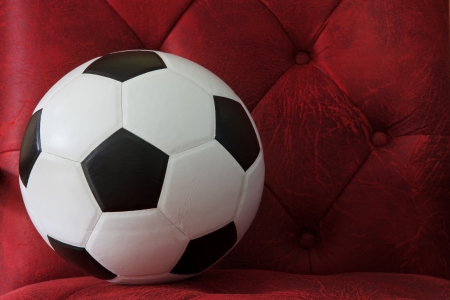 soccer football on red leather background Stock Photo - 15119712